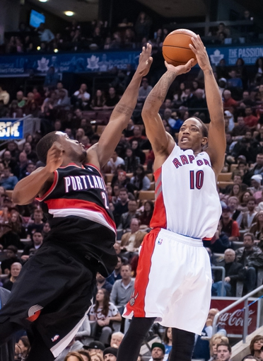 Nov 17, 2013; Toronto, Ontario, CAN; Toronto Raptors shooting guard DeMar DeRozan (10) takes a jump shot with the defense of Portland Trail Blazers shooting guard Wesley Matthews (2) during the fourth quarter of a game at the Air Canada Centre. Portland won the game 118-110. Mandatory Credit: Mark Konezny-USA TODAY Sports