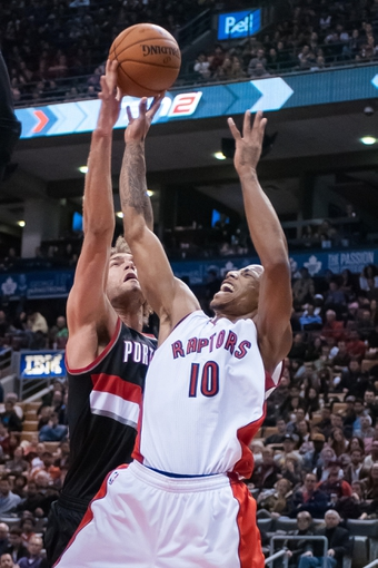 Nov 17, 2013; Toronto, Ontario, CAN; Toronto Raptors shooting guard DeMar DeRozan (10) has his shot blocked by Portland Trail Blazers center Robin Lopez (42) during the fourth quarter of a game at the Air Canada Centre. Portland won the game 118-110. Mandatory Credit: Mark Konezny-USA TODAY Sports