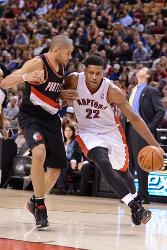 Nov 17, 2013; Toronto, Ontario, CAN; Toronto Raptors small forward Rudy Gay (22) drives the ball with Portland Trail Blazers small forward Nicolas Batum (88) defending during the fourth quarter of a game at the Air Canada Centre. Portland won the game 118-110. Mandatory Credit: Mark Konezny-USA TODAY Sports