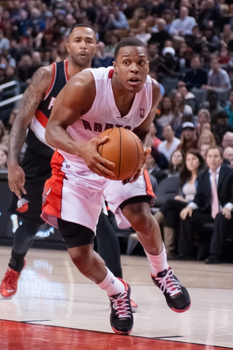 Nov 17, 2013; Toronto, Ontario, CAN; Toronto Raptors point guard Kyle Lowry (7) drives the ball to the basket during the fourth quarter of a game at the Air Canada Centre. Portland won the game 118-110. Mandatory Credit: Mark Konezny-USA TODAY Sports
