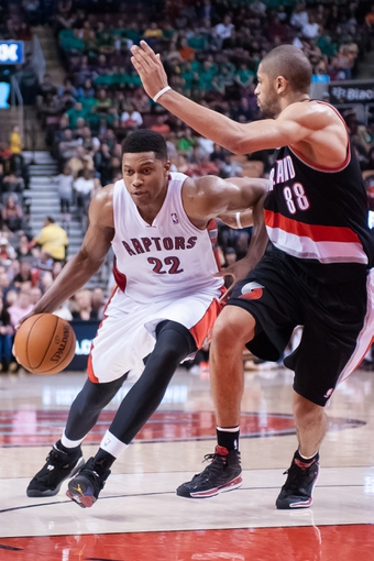 Nov 17, 2013; Toronto, Ontario, CAN; Toronto Raptors small forward Rudy Gay (22) drives the ball against the defense of Portland Trail Blazers small forward Nicolas Batum (88) during an overtime period of a game at the Air Canada Centre. Portland won the game 118-110. Mandatory Credit: Mark Konezny-USA TODAY Sports