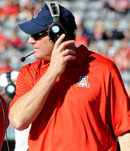 Nov 16, 2013; Tucson, AZ, USA; Arizona Wildcats head coach Rich Rodriguez walks on the sideline during the fourth quarter against the Washington State Cougars at Arizona Stadium. The Cougars beat the Wildcats 24-17. Mandatory Credit: Casey Sapio-USA TODAY Sports