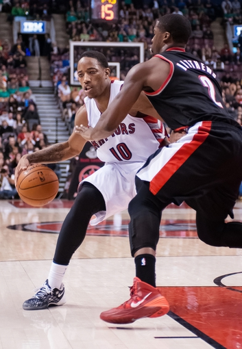 Nov 17, 2013; Toronto, Ontario, CAN; Toronto Raptors shooting guard DeMar DeRozan (10) drives the ball against the defense of Portland Trail Blazers shooting guard Wesley Matthews (2) during an overtime period of a game at the Air Canada Centre. Portland won the game 118-110. Mandatory Credit: Mark Konezny-USA TODAY Sports