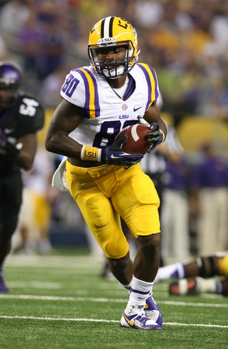 Aug 31, 2013; Arlington, TX, USA; LSU Tigers receiver Jarvis Landry (80) catches a touchdown pass against the Texas Christian Horned Frogs in the fourth quarter at AT&T Stadium. Mandatory Credit: Matthew Emmons-USA TODAY Sports