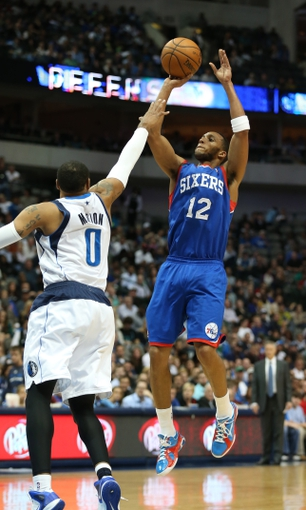 Nov 18, 2013; Dallas, TX, USA; Philadelphia 76ers forward Evan Turner (12) shoots against the Dallas Mavericks at American Airlines Center. Mandatory Credit: Matthew Emmons-USA TODAY Sports