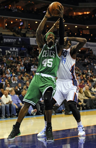 Nov 25, 2013; Charlotte, NC, USA; Boston Celtics forward Gerald Wallace (45) drives to the basket as he is defended by Charlotte Bobcats forward Michael Kidd-Gilchrist (14) during the first half of the game at Time Warner Cable Arena. Mandatory Credit: Sam Sharpe-USA TODAY Sports