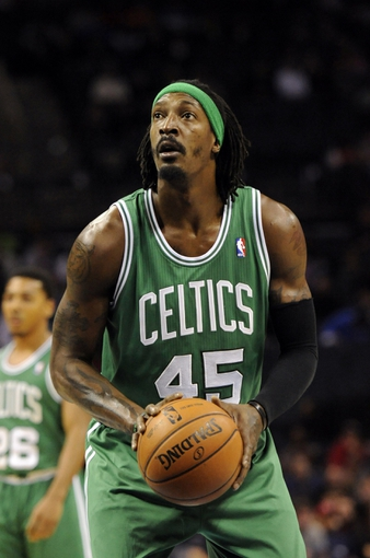 Nov 25, 2013; Charlotte, NC, USA; Boston Celtics forward Gerald Wallace (45) prepares to shoot a foul shot during the first half of the game against the Charlotte Bobcats at Time Warner Cable Arena. Mandatory Credit: Sam Sharpe-USA TODAY Sports