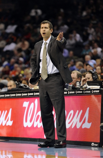 Nov 25, 2013; Charlotte, NC, USA; Boston Celtics head coach Brad Stevens calls out to his team during the first half of the game against the Charlotte Bobcats at Time Warner Cable Arena. Mandatory Credit: Sam Sharpe-USA TODAY Sports