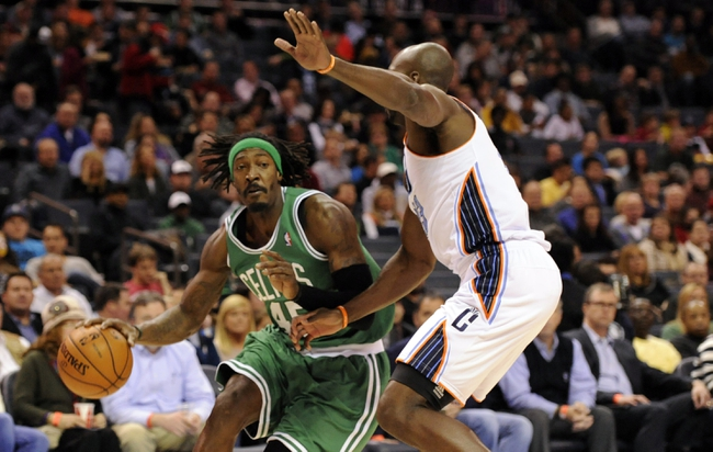 Nov 25, 2013; Charlotte, NC, USA; Boston Celtics forward Gerald Wallace (45) drives past Charlotte Bobcats forward Anthony Tolliver (43) during the first half of the game at Time Warner Cable Arena. Mandatory Credit: Sam Sharpe-USA TODAY Sports