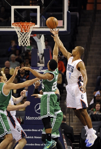 Nov 25, 2013; Charlotte, NC, USA; Charlotte Bobcats guard Ramon Sessions (7) drives to the basket as he is defended by Boston Celtics guard Phil Pressey (26) during the first half of the game at Time Warner Cable Arena. Mandatory Credit: Sam Sharpe-USA TODAY Sports