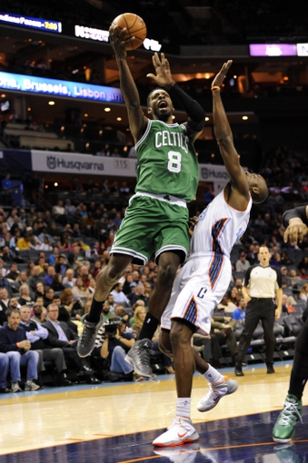 Nov 25, 2013; Charlotte, NC, USA; Boston Celtics guard forward Jeff Green (8) drives to the basket as he is defended by Charlotte Bobcats forward Anthony Tolliver (43) during the first half of the game at Time Warner Cable Arena. Mandatory Credit: Sam Sharpe-USA TODAY Sports