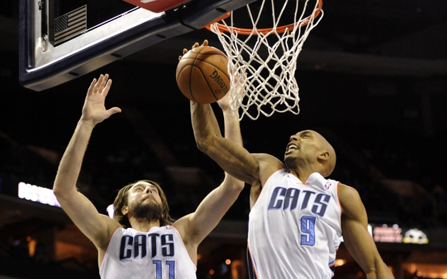 Nov 25, 2013; Charlotte, NC, USA; Charlotte Bobcats guard Gerald Henderson (9) and forward Josh McRoberts (11) go for a rebound during the first half of the game against the Boston Celtics at Time Warner Cable Arena. Mandatory Credit: Sam Sharpe-USA TODAY Sports