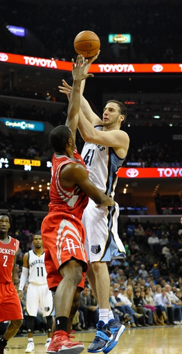Nov 25, 2013; Memphis, TN, USA; Memphis Grizzlies center Kosta Koufos (41) shoots over Houston Rockets power forward Terrence Jones (6) during the second quarter at FedExForum. Mandatory Credit: Justin Ford-USA TODAY Sports
