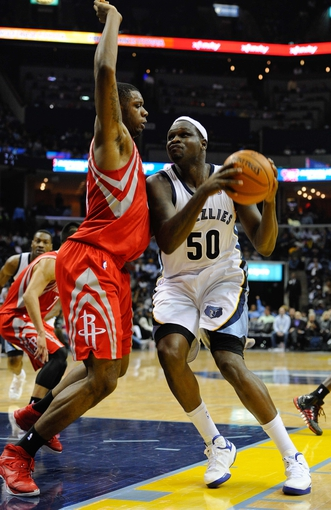Nov 25, 2013; Memphis, TN, USA; Houston Rockets power forward Terrence Jones (6) guards Memphis Grizzlies power forward Zach Randolph (50) during the second quarter at FedExForum. Mandatory Credit: Justin Ford-USA TODAY Sports