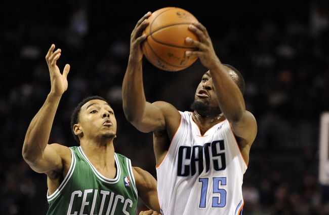 Nov 25, 2013; Charlotte, NC, USA; Charlotte Bobcats guard Kemba Walker (15) drives past Boston Celtics guard Phil Pressey (26) during the second half of the game at Time Warner Cable Arena. Boston wins 96-86. Mandatory Credit: Sam Sharpe-USA TODAY Sports