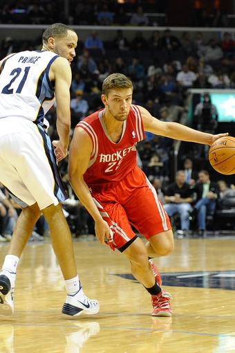 Nov 25, 2013; Memphis, TN, USA; Houston Rockets small forward Chandler Parsons (25) drives to the basket against Memphis Grizzlies small forward Tayshaun Prince (21) during the third quarter at FedExForum. Mandatory Credit: Justin Ford-USA TODAY Sports