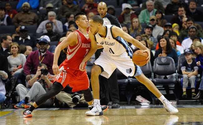 Nov 25, 2013; Memphis, TN, USA; Houston Rockets point guard Jeremy Lin (7) guards Memphis Grizzlies small forward Tayshaun Prince (21) during the third quarter at FedExForum. Mandatory Credit: Justin Ford-USA TODAY Sports