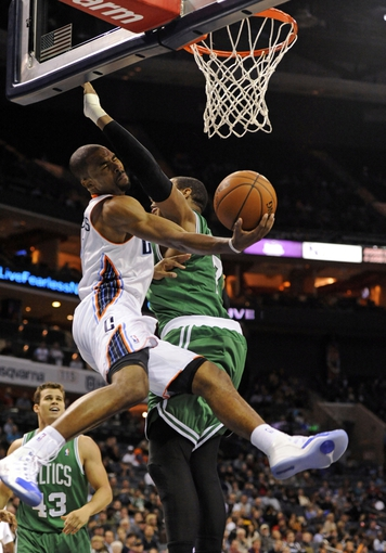 Nov 25, 2013; Charlotte, NC, USA; Charlotte Bobcats guard Ramon Sessions (7) drives to the basket as he is defended by Boston Celtics forward Jared Sullinger (7) during the second half of the game at Time Warner Cable Arena. Celtics win 96-86. Mandatory Credit: Sam Sharpe-USA TODAY Sports