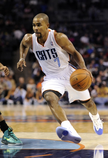 Nov 25, 2013; Charlotte, NC, USA; Charlotte Bobcats guard Ramon Sessions (7) drives to the basket during the second half of the game against the Boston Celtics at Time Warner Cable Arena. Celtics win 96-86. Mandatory Credit: Sam Sharpe-USA TODAY Sports