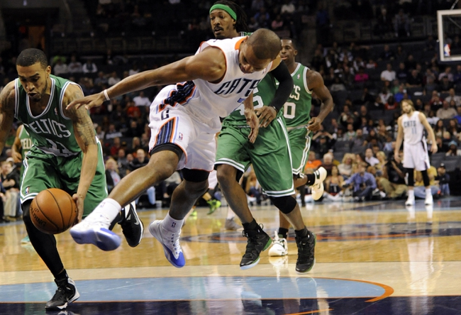 Nov 25, 2013; Charlotte, NC, USA; Charlotte Bobcats guard Ramon Sessions (7) turns the ball over to Boston Celtics guard Courtney Lee (11) during the second half of the game at Time Warner Cable Arena. Celtics win 96-86. Mandatory Credit: Sam Sharpe-USA TODAY Sports