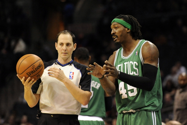 Nov 25, 2013; Charlotte, NC, USA; Boston Celtics forward Gerald Wallace (45) talks to a referee during the second half of the game against the Charlotte Bobcats at Time Warner Cable Arena. Celtics win 96-86. Mandatory Credit: Sam Sharpe-USA TODAY Sports