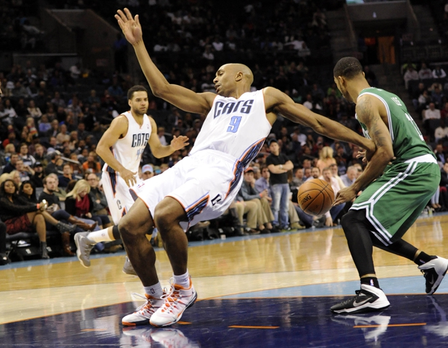 Nov 25, 2013; Charlotte, NC, USA; Charlotte Bobcats guard Gerald Henderson (9) gets the ball stripped by Boston Celtics guard Courtney Lee (11) during the second half of the game at Time Warner Cable Arena. Celtics win 96-86. Mandatory Credit: Sam Sharpe-USA TODAY Sports