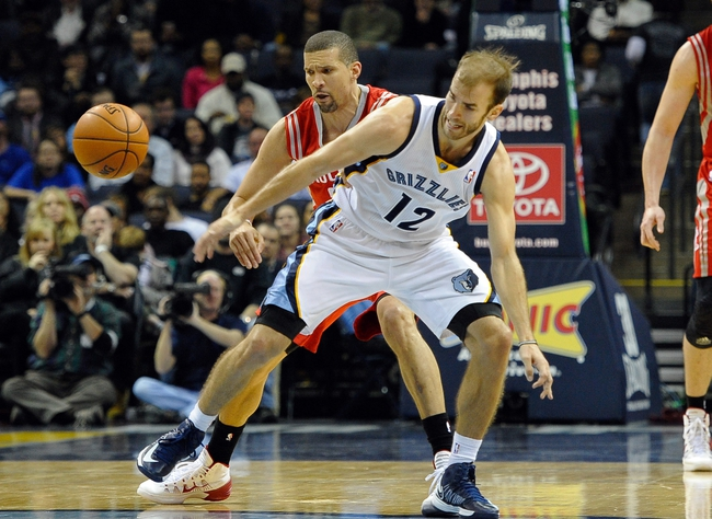 Nov 25, 2013; Memphis, TN, USA; Houston Rockets shooting guard Francisco Garcia (32) and Memphis Grizzlies shooting guard Nick Calathes (12) fight for the ball during the fourth quarter at FedExForum. Mandatory Credit: Justin Ford-USA TODAY Sports