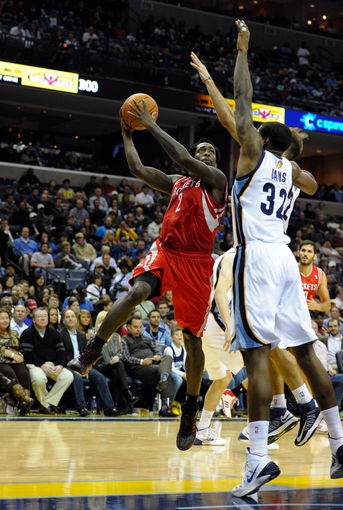 Nov 25, 2013; Memphis, TN, USA; Houston Rockets point guard Patrick Beverley (2) lays the ball up over Memphis Grizzlies power forward Ed Davis (32) during the fourth quarter at FedExForum. Mandatory Credit: Justin Ford-USA TODAY Sports