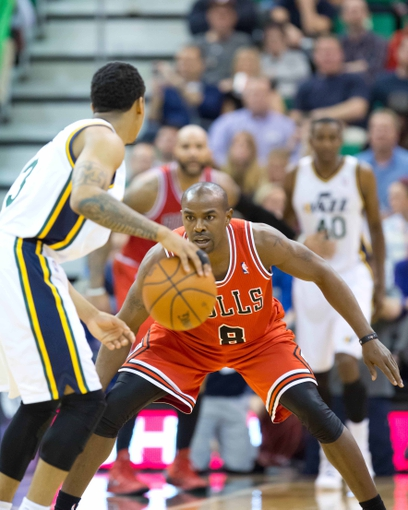 Nov 25, 2013; Salt Lake City, UT, USA; Chicago Bulls point guard Mike James (8) defends against Utah Jazz point guard Trey Burke (3) during the first half at EnergySolutions Arena. Mandatory Credit: Russ Isabella-USA TODAY Sports