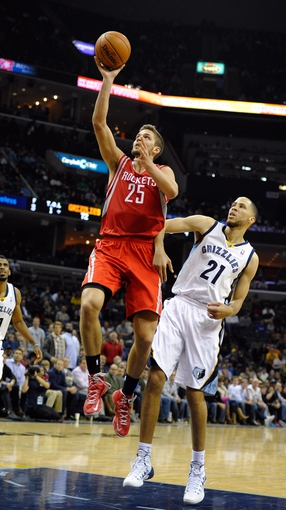 Nov 25, 2013; Memphis, TN, USA; Houston Rockets small forward Chandler Parsons (25) shoots the ball against Memphis Grizzlies small forward Tayshaun Prince (21) during the fourth quarter at FedExForum. Houston Rockets beat the Memphis Grizzlies 93-86. Mandatory Credit: Justin Ford-USA TODAY Sports