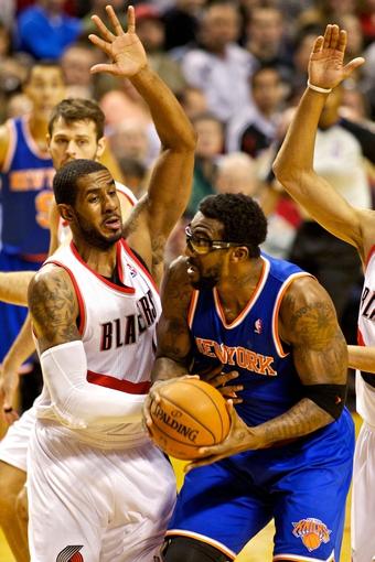 Nov 25, 2013; Portland, OR, USA; New York Knicks power forward Amar'e Stoudemire (1) drives to the basket as Portland Trail Blazers power forward LaMarcus Aldridge (12) defends at the Moda Center. Mandatory Credit: Craig Mitchelldyer-USA TODAY Sports