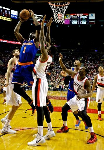 Nov 25, 2013; Portland, OR, USA; New York Knicks power forward Amar'e Stoudemire (1) shoots over Portland Trail Blazers power forward Thomas Robinson (41) at the Moda Center. Mandatory Credit: Craig Mitchelldyer-USA TODAY Sports