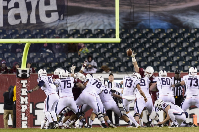 Nov 23, 2013; Philadelphia, PA, USA; Connecticut Huskies kicker Chad Christen (13) kicks a PAT during the fourth quarter against the Temple Owls at Lincoln Financial Field. UCONN defeated Temple 28-21. Mandatory Credit: Howard Smith-USA TODAY Sports