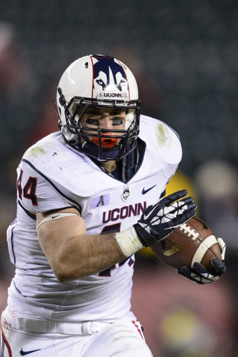 Nov 23, 2013; Philadelphia, PA, USA; Connecticut Huskies running back Max DeLorenzo (44) carries the ball during the fourth quarter against the Temple Owls at Lincoln Financial Field. UCONN defeated Temple 28-21. Mandatory Credit: Howard Smith-USA TODAY Sports