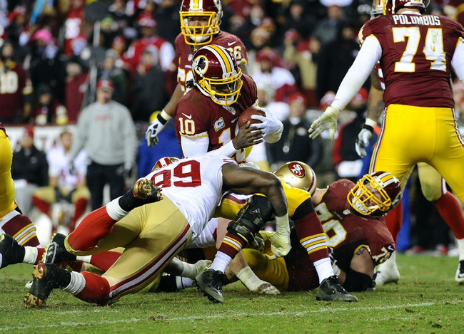 Nov 25, 2013; Landover, MD, USA; San Francisco 49ers linebacker Aldon Smith (99) sacks Washington Redskins quarterback Robert Griffin III (10) during the second half at FedEx Field. The 49ers won 27-6. Mandatory Credit: Brad Mills-USA TODAY Sports