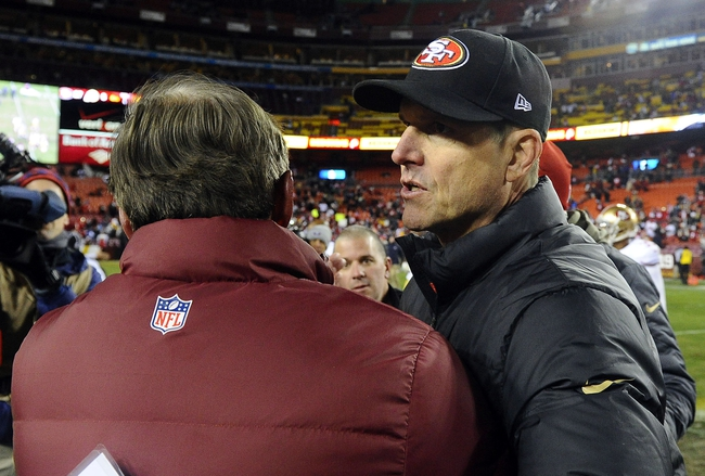 Nov 25, 2013; Landover, MD, USA; San Francisco 49ers head coach Jim Harbaugh greets Washington Redskins head coach Mike Shanahan after the game at FedEx Field. The 49ers won 27-6. Mandatory Credit: Brad Mills-USA TODAY Sports
