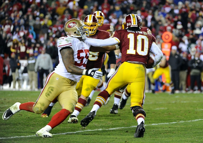 Nov 25, 2013; Landover, MD, USA; San Francisco 49ers linebacker Ahmad Brooks (55) sacks Washington Redskins quarterback Robert Griffin III (10) during the second half at FedEx Field. The 49ers won 27-6. Mandatory Credit: Brad Mills-USA TODAY Sports