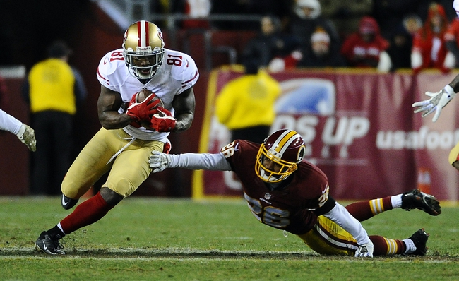 Nov 25, 2013; Landover, MD, USA; San Francisco 49ers wide receiver Anquan Boldin (81) runs after making a reception as Washington Redskins cornerback Josh Wilson (26) defends during the second half at FedEx Field. The 49ers won 27-6. Mandatory Credit: Brad Mills-USA TODAY Sports