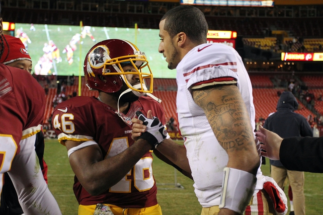 Nov 25, 2013; Landover, MD, USA; Washington Redskins running back Alfred Morris (46) shakes hands with San Francisco 49ers quarterback Colin Kaepernick (7) after their game at FedEx Field. The 49ers won 27-6. Mandatory Credit: Geoff Burke-USA TODAY Sports