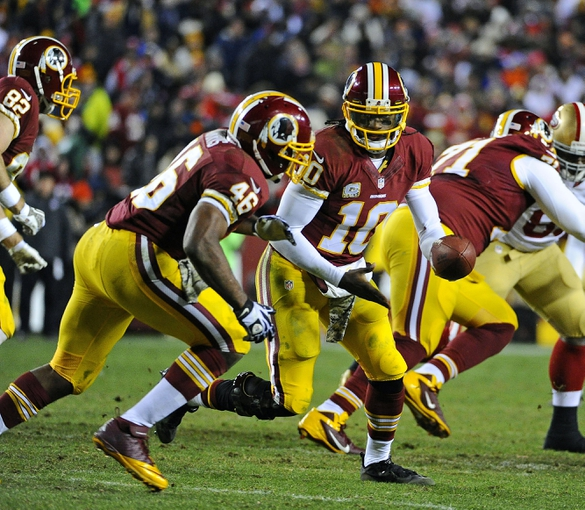 Nov 25, 2013; Landover, MD, USA; Washington Redskins quarterback Robert Griffin III (10) prepares to handoff to running back Alfred Morris (46) against the San Francisco 49ers during the second half at FedEx Field. The 49ers won 27-6. Mandatory Credit: Brad Mills-USA TODAY Sports