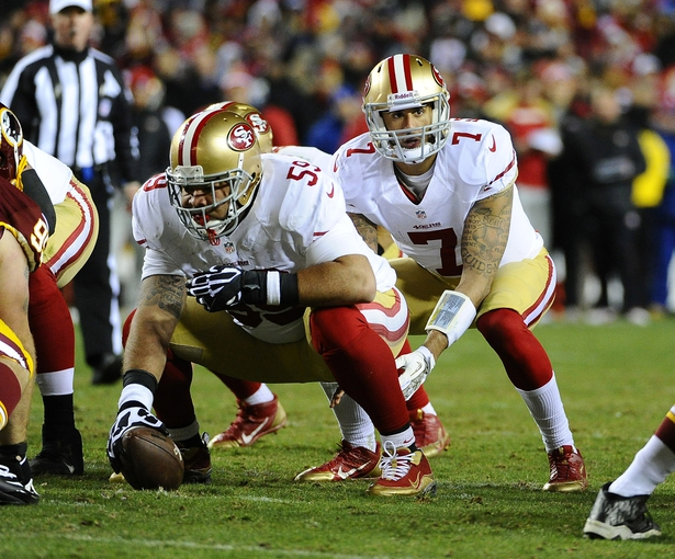 Nov 25, 2013; Landover, MD, USA; San Francisco 49ers center Jonathan Goodwin (59) prepares to snap the ball to quarterback Colin Kaepernick (7) against the Washington Redskins during the second half at FedEx Field. The 49ers won 27-6. Mandatory Credit: Brad Mills-USA TODAY Sports