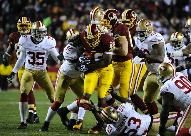 Nov 25, 2013; Landover, MD, USA; Washington Redskins running back Alfred Morris (46) is tackled by San Francisco 49ers linebacker Patrick Willis (52) and  linebacker NaVorro Bowman (53) during the second half at FedEx Field. The 49ers won 27-6. Mandatory Credit: Brad Mills-USA TODAY Sports