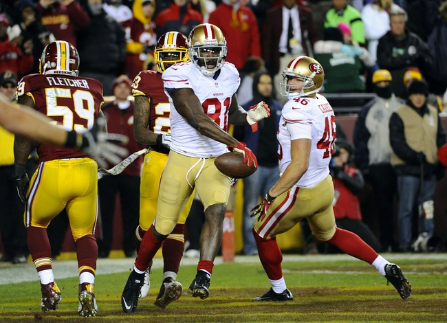 Nov 25, 2013; Landover, MD, USA; San Francisco 49ers wide receiver Anquan Boldin (81) celebrates after scoring a touchdown against the Washington Redskins during the second half at FedEx Field. The 49ers won 27-6. Mandatory Credit: Brad Mills-USA TODAY Sports