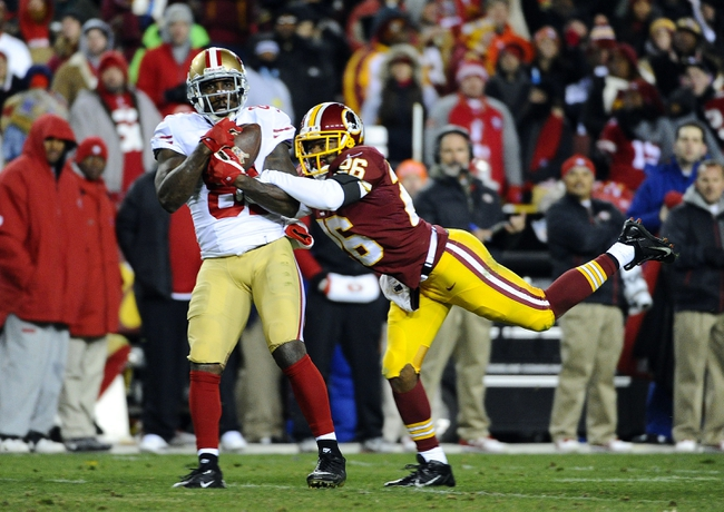 Nov 25, 2013; Landover, MD, USA; San Francisco 49ers wide receiver Anquan Boldin (81) makes a reception as Washington Redskins cornerback Josh Wilson (26) defends during the second half at FedEx Field. The 49ers won 27-6. Mandatory Credit: Brad Mills-USA TODAY Sports