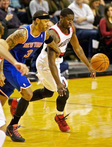 Nov 25, 2013; Portland, OR, USA; New York Knicks power forward Kenyon Martin (3) and Portland Trail Blazers shooting guard Wesley Matthews (2) fight for a loose ball at the Moda Center. Mandatory Credit: Craig Mitchelldyer-USA TODAY Sports
