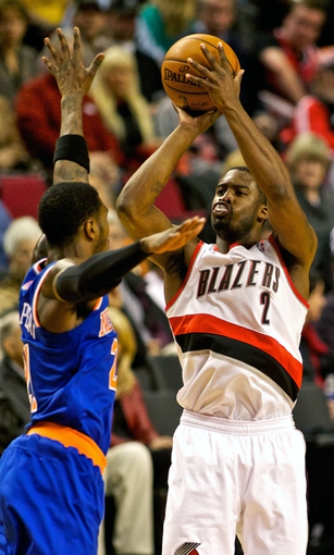 Nov 25, 2013; Portland, OR, USA; Portland Trail Blazers shooting guard Wesley Matthews (2) shoots over New York Knicks shooting guard Iman Shumpert (21) at the Moda Center. Mandatory Credit: Craig Mitchelldyer-USA TODAY Sports