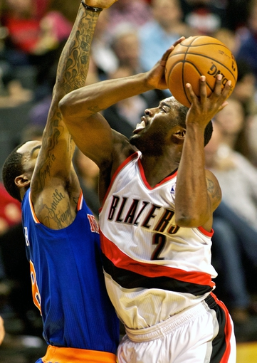 Nov 25, 2013; Portland, OR, USA; Portland Trail Blazers shooting guard Wesley Matthews (2) shoots over New York Knicks shooting guard J.R. Smith (8) at the Moda Center. Mandatory Credit: Craig Mitchelldyer-USA TODAY Sports