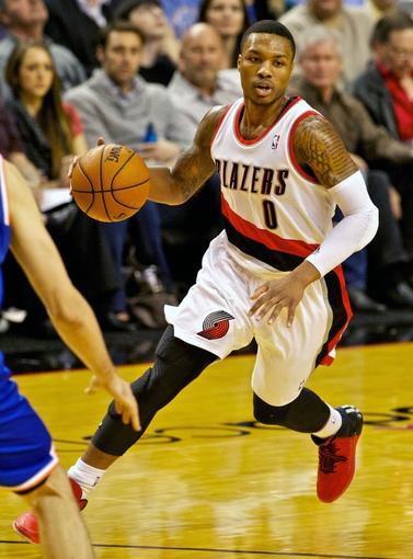 Nov 25, 2013; Portland, OR, USA; Portland Trail Blazers point guard Damian Lillard (0) brings the ball up court against the New York Knicks at the Moda Center. Mandatory Credit: Craig Mitchelldyer-USA TODAY Sports
