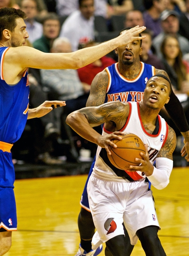 Nov 25, 2013; Portland, OR, USA; Portland Trail Blazers point guard Damian Lillard (0) shoots organist the New York Knicks at the Moda Center. Mandatory Credit: Craig Mitchelldyer-USA TODAY Sports