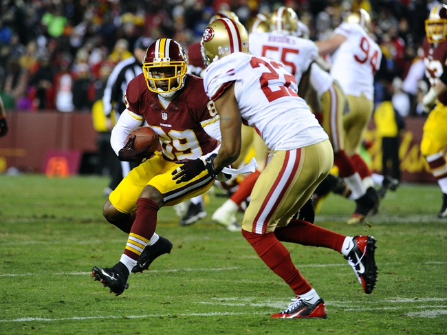 Nov 25, 2013; Landover, MD, USA; Washington Redskins wide receiver Santana Moss (89) runs after a reception as San Francisco 49ers cornerback Carlos Rogers (22) defends during the second half at FedEx Field. The 49ers won 27-6. Mandatory Credit: Brad Mills-USA TODAY Sports